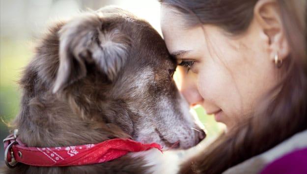 Woman hugging her dog